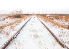 Landscape of Snowy Train Tracks Stock Photo