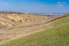 Landscape with soil erosion at early spring season in outskirts of Dnepr city, Ukraine Royalty Free Stock Photo