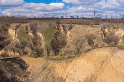 Landscape with soil erosion at early spring season in Ukraine Stock Photos