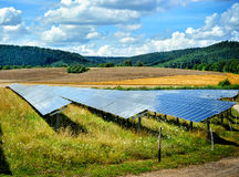 Landscape with solar energy field Stock Photos