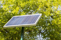 Landscape of solar panels located in a park Stock Photo