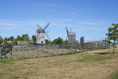 Landscape with some wooden wind mills. Image of Landscape with some wooden wind mills Stock Photos