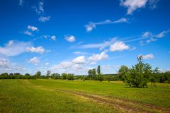 Landscape at Sopot in Vinkovci. A pathway through the green meadow next to river Bosut near Vinkovci, Croatia Stock Photos
