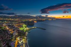 Landscape of Sorrento in a spectacular blue hour. With clouds colored stock photo