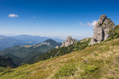 Landscape with spectacular rocks and mountain range Royalty Free Stock Image