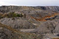 Spent clay quarry with multi-colored slopes. Landscape of spent clay quarry with eroded multi-colored slopes Royalty Free Stock Photo