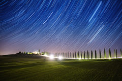 Landscape with star trails Stock Images