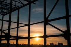 Landscape of steel building frame on background of sunrise.  stock photos