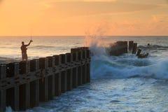 Landscape Hatteras NC Bulkhead Groin Fisherman Sun Royalty Free Stock Image