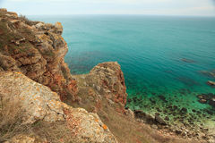 Landscape stone coast and turquoise black sea Stock Photography