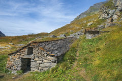 Landscape with stone houses in Swiss Alps Stock Images