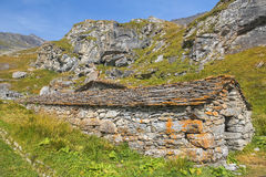 Landscape with stone houses in Swiss Alps Royalty Free Stock Images