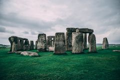 Stonehenge landscape in England,. Landscape of Stonehenge in England, perfect use for background images. very green and cloudy image stock photo