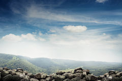 Landscape of stones, forest and sky Stock Photo