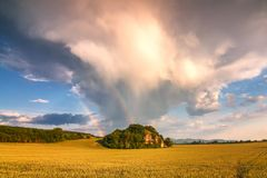 Landscape with dramatic sky and rainbow. Royalty Free Stock Photos