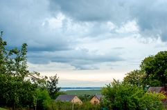 Landscape before the storm, small village royalty free stock images