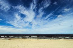 Landscape with stratocumulus clouds on the sky over the Baltic sea beach. Stegna, Pomerania, Poland royalty free stock images