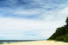 Landscape with stratocumulus clouds on the sky over the Baltic sea beach. Stegna, Pomerania, Poland royalty free stock image