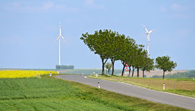 Landscape with street and wind turbines Royalty Free Stock Photos