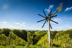 Landscape. Styrian Tuscany Vineyard with windmill -klapotetz in foreground, Austria Royalty Free Stock Images