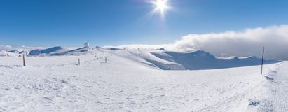 Landscape on the summit of mountain helmos with snow stock photo