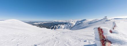 Landscape on the summit of mountain helmos with snow stock photography