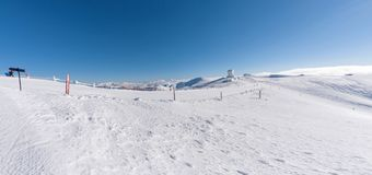 Landscape on the summit of mountain helmos with snow royalty free stock photos