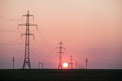 Landscape sun on a power line transmission Stock Image