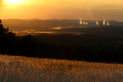 Landscape during sun set with power plant Stock Photos