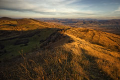 Landscape with sun setting over hills Royalty Free Stock Photography