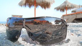 Landscape of sunglasses in the sand. Landscape of  black sunglasses in the sand Royalty Free Stock Image
