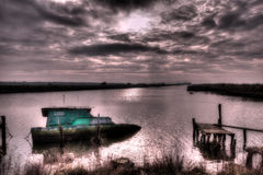 Landscape with sunken boat Royalty Free Stock Photo