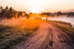 Landscape, sunny dawn with road and fisher stock image