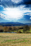 Landscape with sunny sky stock image