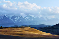 Landscape with sunny valley and snowy mountains Royalty Free Stock Image