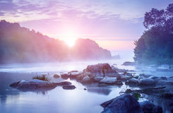 Landscape with sunrise and mist over river Stock Photography