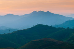 Landscape of sunrise over mountains Stock Photography