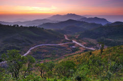 Landscape of sunrise over mountains in Kanchanabur Royalty Free Stock Image