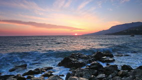 Landscape with sunrise over sea and rocks stock video footage