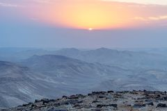 Landscape of sunrise and yellow red and violet clouds. Magic judean desert in Israel. Beautiful travel outdoor nature Stock Photo