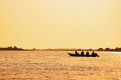 Landscape at sunset of a boat with fishermen fishing on Pantanal stock photos