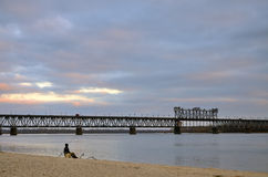 Landscape at sunset bridge river and cloudy sky Stock Photography