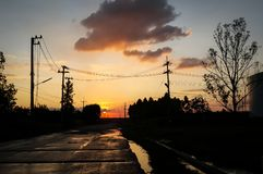 Landscape sunset with cloud have wet road stock photography