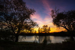 Landscape of sunset with cloudy orange sky Royalty Free Stock Photos
