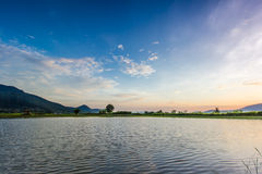 Landscape with sunset over lake Royalty Free Stock Photo