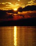 Landscape of sunset over the lake and mountains. Cloudy sky. Iznik, Bursa, Turkey.  stock photos
