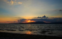 Landscape with sunset in the sea Stock Photo