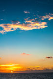 Landscape of Sunset on the sea. A bright orange and blue sky above sea in autumn Royalty Free Stock Images