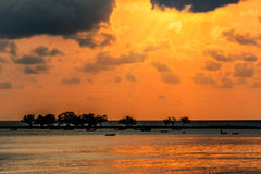 Landscape sunset, the sea waves, fishing boat in Thailand Stock Photos