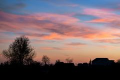 Landscape, sunset or sunrise, the sky covered with picturesque c. Louds Stock Images
